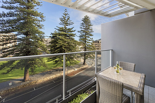 vegetarian meal option on table on private balcony of 2 bedroom apartment at Oaks Liberty Towers hotel in Glenelg, South Australia