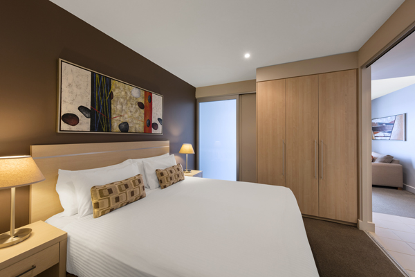 Air conditioned accommodation Glenelg bedroom with large wardrobe  big  mirror and en suite bathroom on. Oaks Plaza Pier   Accommodation Glenelg