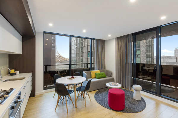 Hotels Southbank Melbourne with large living room with modern furniture in big 2 Bedroom Apartment with private balcony at Oaks Southbank hotel in Melbourne city, Victoria, Australia