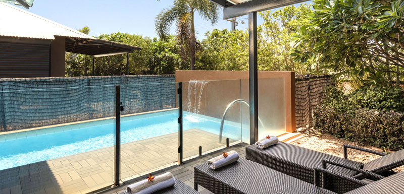 sun loungers in private courtyard of hotel apartment with private swimming pool in Broome, Western Australia