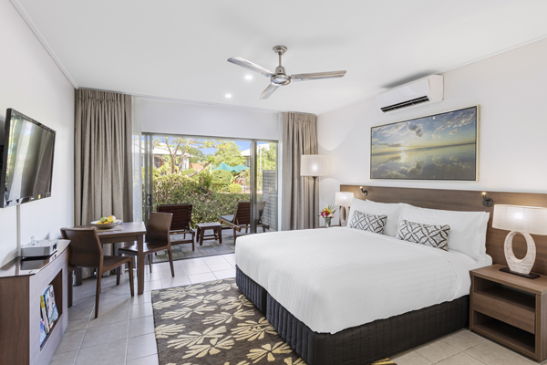 air conditioned bedroom with comfortable double bed, modern furniture, Foxtel and Wi-Fi in hotel Studio apartment at Oaks Cable Beach Sanctuary holiday accommodation in Broome, Western Australia