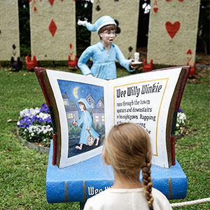 little kid reading a storybook at hunter valley