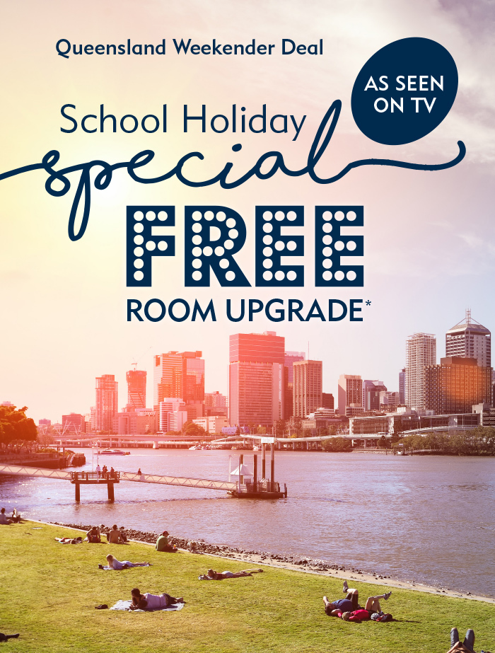 Family on school holidays in Queensland staying at Oaks Hotels Brisbane city enjoying Room Upgrade to 2 Bedroom Hotel Apartment