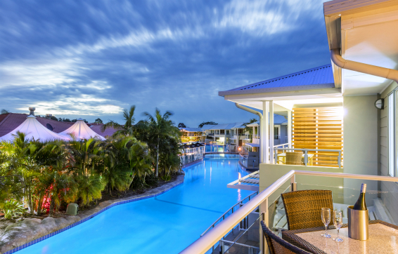 Best Port Stephens hotels balcony overlooking large pool at dusk during summer holidays in New South Wales, Australia