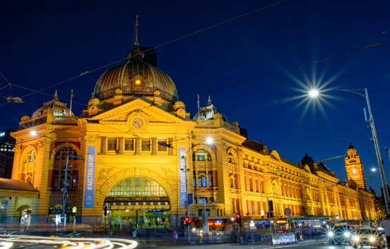Night image of Oaks hotels in Victoria overlooking Flinders Street train station in Melbourne, VIC, Australia