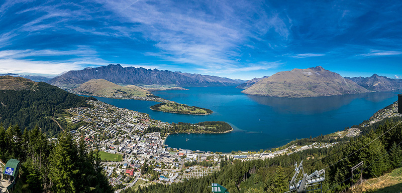 beautiful panoramic view of Queenstown in New Zealand from helicopter flying over Oaks Club Resort in Queenstown, New Zealand