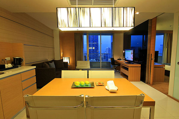 vegetarian menu option on dining table in kitchen with microwave, kettle, toaster and fridge in 1 Bedroom Suite at Oaks Bangkok Sathorn hotel apartments in Thailand