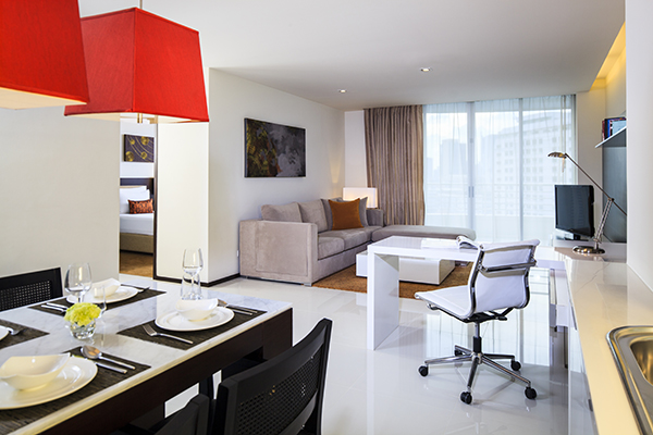 spacious living room in hotels In Bangkok with air conditioning, Wi-Fi access and satellite TV in Two Bedroom Suite at Oaks Bangkok Sathorn hotel apartments in Thailand