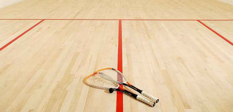hotel guests playing on air conditioned squash court at Oaks Liwa Heights in Dubai, United Arab Emirates